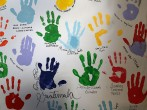 Hand prints of students learning English from volunteers