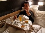 Famous Traveler, Sam Chui, enjoys a gourmet meal in bed while on the Residence at Etihad