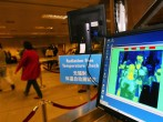 Thermal Screening Is Used To Check Passengers For SARS In Singapore