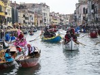 Rowers dresses with costumes take part in the traditional regatta on the Grand Canal