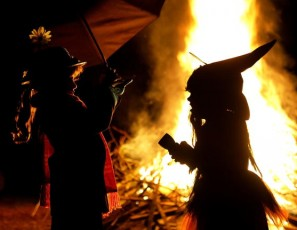 Children in Halloween Costumes Stand Near Bon Fire