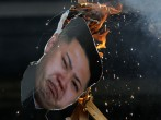 South Korean conservative protesters burn an effigy of North Korean leader Kim Jong-Un during an anti-North Korea protest marking the second anniversary of former North Korean leader Kim Jong Il's death on December 17, 2013 in Seoul, South Korea.
