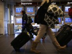 Holiday Travelers Crowd Airports And Roads Ahead Of Thanksgiving Holiday