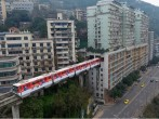 Train goes through centre of a block of flats in China