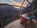 View from the transparent luxury capsule rested on the edge of a cliff